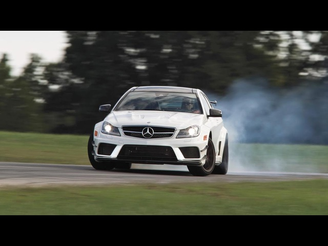 Drifting 2013 Mercedes-Benz C63 AMG Coupe Black Series Chased by a Cop Car at VIR