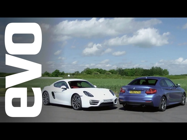 Porsche Cayman vs <em>BMW</em> M235i | evo TRACK BATTLE
